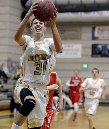 """Monarch High School's Ben Beauchamp drives to the hoop during a game against Chaparral High School on Friday, Nov. 30, at Monarch High School in Louisville. For more photos of the game go to  <a href=""""http://www.dailycamera.com"""">http://www.dailycamera.com</a><br /> Jeremy Papasso/ Camera"""