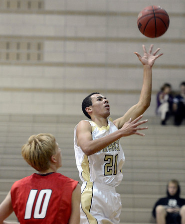 """Monarch High School's Marcus Stewart takes a shot over Jake Holtzmann during a game against Chaparral High School on Friday, Nov. 30, at Monarch High School in Louisville. For more photos of the game go to  <a href=""""http://www.dailycamera.com"""">http://www.dailycamera.com</a><br /> Jeremy Papasso/ Camera"""