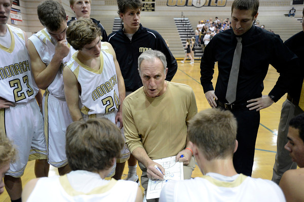 "Monarch High School Head Coach Kevin Niven goes over a game plan with his team in a time-out during a game against Chaparral High School on Friday, Nov. 30, at Monarch High School in Louisville. For more photos of the game go to  <a href=""http://www.dailycamera.com"">http://www.dailycamera.com</a><br /> Jeremy Papasso/ Camera"