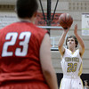 "Monarch High School's Alex Young takes a shot over Chase Coon during a game against Chaparral High School on Friday, Nov. 30, at Monarch High School in Louisville. For more photos of the game go to  <a href=""http://www.dailycamera.com"">http://www.dailycamera.com</a><br /> Jeremy Papasso/ Camera"