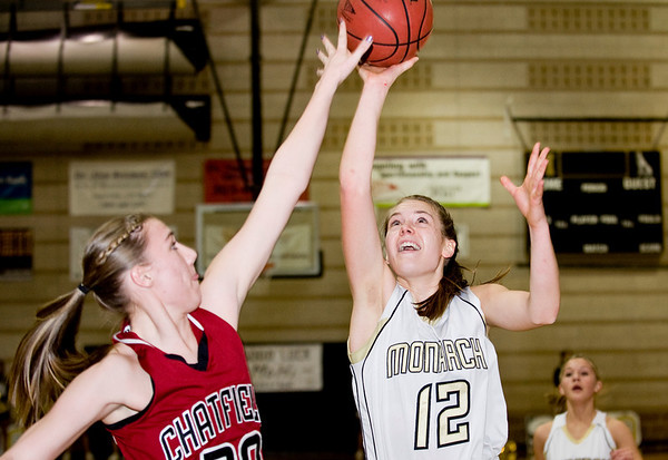 Monarch High School senior Mattie Stanford takes a shot over Chatfield's Brittany Bame on Friday, Feb. 25, during a basketball game against Chatfield High School at Monarch. Monarch defeated Chatfield 66-38.<br /> Jeremy Papasso/ Camera