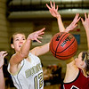 Monarch High School senior Mattie Stanford gets her shot deflected by Chatfield's Kaylee Millar on Friday, Feb. 25, during a basketball game against Chatfield High School at Monarch. Monarch defeated Chatfield 66-38.<br /> Jeremy Papasso/ Camera