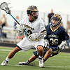 "Monarch High School's Nate Puldy hustles past Evergreen's Mike Rogers as he drives towards the goal during a lacrosse game against Evergreen High School at Monarch on Friday, May, 6. Monarch won the game 11-5. For more photos go to  <a href=""http://www.dailycamera.com"">http://www.dailycamera.com</a><br /> Jeremy Papasso/ Camera"
