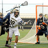 """Monarch High School's Nate Puldy, center, tries to work his way past Evergreen defenders during a lacrosse game against Evergreen High School at Monarch on Friday, May, 6. Monarch won the game 11-5. For more photos go to  <a href=""""http://www.dailycamera.com"""">http://www.dailycamera.com</a><br /> Jeremy Papasso/ Camera"""