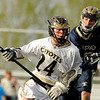 "Monarch High School's Dylan Ritger rushes past Evergreen's Tyler Cooper during a lacrosse game against Evergreen High School at Monarch on Friday, May, 6. Monarch won the game 11-5. For more photos go to  <a href=""http://www.dailycamera.com"">http://www.dailycamera.com</a><br /> Jeremy Papasso/ Camera"