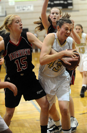 MONARCH<br /> Monarch's Eliza Norman fights to keep the ball against Kristen Narum of Fairview. <br /> photo by Marty Caivano/Jan. 10, 2011