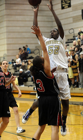 MONARCH<br /> Monarch's Alexus Johnson shoots over Carlee Lough of Fairview. <br /> photo by Marty Caivano/Jan. 10, 2011