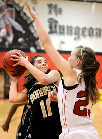 """Monarch High School junior Rebecca Richmond drives towards the hoop on Friday, Feb. 11, during a basketball game against Fairview High School at Fairview. Monarch defeated Fairview 44-37. For more photos go to  <a href=""""http://www.dailycamera.com"""">http://www.dailycamera.com</a><br /> Jeremy Papasso/ Camera"""