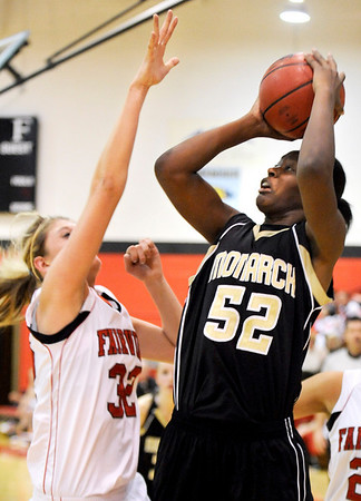 "Monarch High School junior Alexus Johnson shoots a two-pointer over Fairview's Georgina Ryder on Friday, Feb. 11, during a basketball game against Fairview High School at Fairview. Monarch defeated Fairview 44-37. For more photos go to  <a href=""http://www.dailycamera.com"">http://www.dailycamera.com</a><br /> Jeremy Papasso/ Camera"