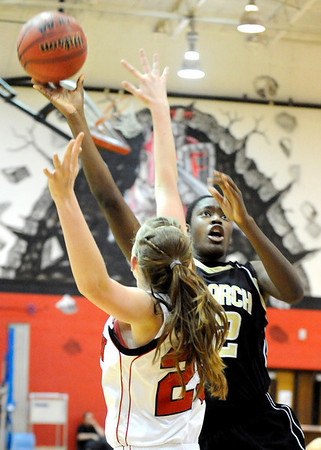 "Monarch High School junior Alexus Johnson takes a shot over a Fairview defender on Friday, Feb. 11, during a basketball game against Fairview High School at Fairview. Monarch defeated Fairview 44-37. For more photos go to  <a href=""http://www.dailycamera.com"">http://www.dailycamera.com</a><br /> Jeremy Papasso/ Camera"