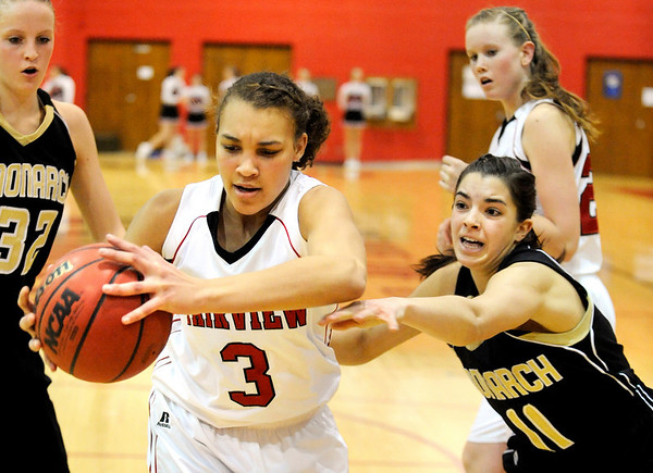 "Fairview High School senior Carlee Lough grabs a rebound from Monarch's Rebecca Richmond, right, on Friday, Feb. 11, during a basketball game at Fairview High School. Monarch defeated Fairview 44-37. For more photos go to  <a href=""http://www.dailycamera.com"">http://www.dailycamera.com</a><br /> Jeremy Papasso/ Camera"