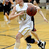 MONARCH01<br /> Monarch's Alex Evans drives past Nina Ball of Fairview.<br /> Photo by Marty Caivano/Camera/March 3, 2010