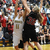 MONARCH02<br /> Monarch's Rebecca Richmond tries to shoot while under pressure from Sierra Bender of Fairview.<br /> Photo by Marty Caivano/Camera/March 3, 2010