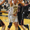 MONARCH07<br /> Monarch's Alex Evans struggles to maintain control of a rebound against Caitlin Higgins of Fairview.<br /> Photo by Marty Caivano/Camera/March 3, 2010