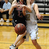 MONARCH04<br /> Monarch's Mattie Stanford, right, knocks the ball away from Nina Ball of Fairview after Ball grabbed a rebound.<br /> Photo by Marty Caivano/Camera/March 3, 2010