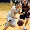 MONARCH03<br /> Monarch's Hannah Stimac pushes past Cassie Corrigan of Fairview.<br /> Photo by Marty Caivano/Camera/March 3, 2010