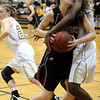 MONARCH05<br /> Fairview's Nina Ball is fouled by Alexus Johnson of Monarch.<br /> Photo by Marty Caivano/Camera/March 3, 2010