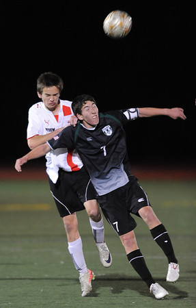 "Enda O'Neill, left, of Fairview, and Jake Nelson of Fossil Ridge, battle for the ball.<br /> For more photos of the game, go to  <a href=""http://www.dailycamera.com"">http://www.dailycamera.com</a>.<br /> Cliff Grassmick / October 13, 2011"