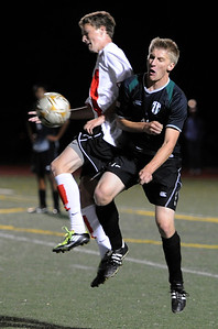 Eric Kronenberg, left, of Fairview, and Alex Born of Fossil Ridge, battle for the ball. For more photos of the game, go to www.dailycamera.com. Cliff Grassmick / October 13, 2011