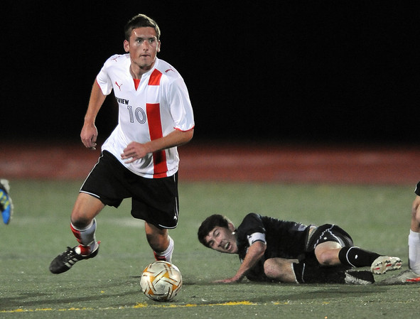 "Shane O'Neill, left, of Fairview, heads down field, after getting rid of Jake Nelson of Fossil Ridge.<br /> For more photos of the game, go to  <a href=""http://www.dailycamera.com"">http://www.dailycamera.com</a>.<br /> Cliff Grassmick / October 13, 2011"