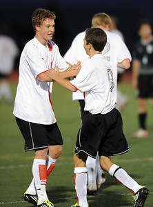 Eric Kronenberg, left, of Fairview, gets congratulated by Bryan Windsor, after scoring a goal in the Fossil Ridge game. For more photos of the game, go to www.dailycamera.com. Cliff Grassmick / October 13, 2011