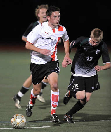 """Shane O'Neill, left, of Fairview, heads down field past Nate Blank of Fossil Ridge.<br /> For more photos of the game, go to  <a href=""""http://www.dailycamera.com"""">http://www.dailycamera.com</a>.<br /> Cliff Grassmick / October 13, 2011"""