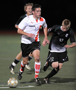 Shane O'Neill, left, of Fairview, heads down field past Nate Blank of Fossil Ridge. For more photos of the game, go to www.dailycamera.com. Cliff Grassmick / October 13, 2011