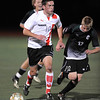 "Shane O'Neill, left, of Fairview, heads down field past Nate Blank of Fossil Ridge.<br /> For more photos of the game, go to  <a href=""http://www.dailycamera.com"">http://www.dailycamera.com</a>.<br /> Cliff Grassmick / October 13, 2011"