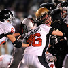 Monarch's Clay Chamberlin (middle right) gets the first down before being stopped by Loveland's A.J. Steele (left), Mike Chouanard (middle left) and Caleb Tebbe (right) during their football game at Centaurus in Lafayette, Colorado November 20, 2009. CAMERA/Mark Leffingwell
