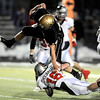 Monarch's Conner Dunn (left) leaps over Loveland's Mike Chouanard (right) for touchdown during their football game at Centaurus in Lafayette, Colorado November 20, 2009. CAMERA/Mark Leffingwell