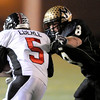 Monarch's Tyler Slade (right) stops Loveland's Andrew Eberle (left) after a short gain during their football game at Centaurus in Lafayette, Colorado November 20, 2009. CAMERA/Mark Leffingwell