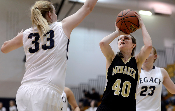 "Monarch High School's Jordan Eisler takes a shot in front of Courtney Smith during a game against Legacy High School on Friday, Jan. 11, at Legacy High School in Broomfield. For more photos of the game go to  <a href=""http://www.dailycamera.com"">http://www.dailycamera.com</a><br /> Jeremy Papasso/ Camera"
