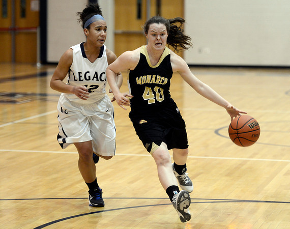 "Monarch High School's Jordan Eisler dribbles past Mackenzie Neely during a game against Legacy High School on Friday, Jan. 11, at Legacy High School in Broomfield. For more photos of the game go to  <a href=""http://www.dailycamera.com"">http://www.dailycamera.com</a><br /> Jeremy Papasso/ Camera"