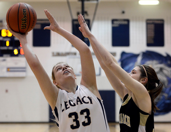 """Legacy High School's Courtney Smith takes a shot over Kelly O'Flannagan during a game against Monarch High School on Friday, Jan. 11, at Legacy High School in Broomfield. For more photos of the game go to  <a href=""""http://www.dailycamera.com"""">http://www.dailycamera.com</a><br /> Jeremy Papasso/ Camera"""