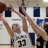 "Legacy High School's Courtney Smith takes a shot over Kelly O'Flannagan during a game against Monarch High School on Friday, Jan. 11, at Legacy High School in Broomfield. For more photos of the game go to  <a href=""http://www.dailycamera.com"">http://www.dailycamera.com</a><br /> Jeremy Papasso/ Camera"