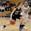 "Monarch High School's Kelly O'Flannigan dribbles past Emiley Lopez during a game against Legacy High School on Friday, Jan. 11, at Legacy High School in Broomfield. For more photos of the game go to  <a href=""http://www.dailycamera.com"">http://www.dailycamera.com</a><br /> Jeremy Papasso/ Camera"