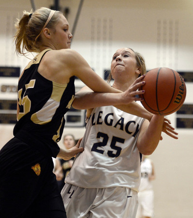 "Legacy High School's Bree Paulson gets fouled by Raegen Rohn during a game against Monarch High School on Friday, Jan. 11, at Legacy High School in Broomfield. For more photos of the game go to  <a href=""http://www.dailycamera.com"">http://www.dailycamera.com</a><br /> Jeremy Papasso/ Camera"