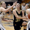"Monarch High School's Francesca Cendali gets fouled by Courtney Smith during a game against Legacy High School on Friday, Jan. 11, at Legacy High School in Broomfield. For more photos of the game go to  <a href=""http://www.dailycamera.com"">http://www.dailycamera.com</a><br /> Jeremy Papasso/ Camera"