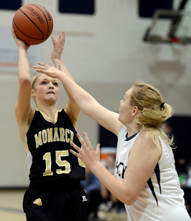 """Monarch High School's Raegen Rohn takes a shot over Courtney Smith during a game against Legacy High School on Friday, Jan. 11, at Legacy High School in Broomfield. For more photos of the game go to  <a href=""""http://www.dailycamera.com"""">http://www.dailycamera.com</a><br /> Jeremy Papasso/ Camera"""