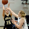 "Monarch High School's Raegen Rohn takes a shot over Courtney Smith during a game against Legacy High School on Friday, Jan. 11, at Legacy High School in Broomfield. For more photos of the game go to  <a href=""http://www.dailycamera.com"">http://www.dailycamera.com</a><br /> Jeremy Papasso/ Camera"