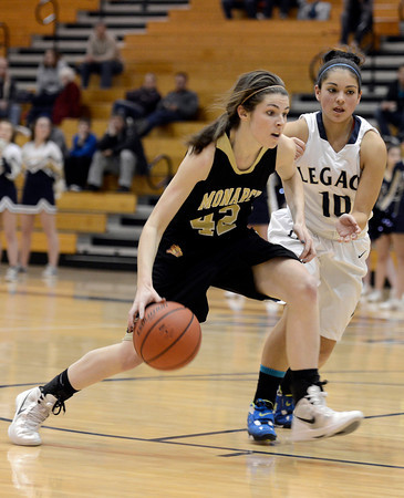 """Monarch High School's Kelly O'Flannigan dribbles past Emiley Lopez during a game against Legacy High School on Friday, Jan. 11, at Legacy High School in Broomfield. For more photos of the game go to  <a href=""""http://www.dailycamera.com"""">http://www.dailycamera.com</a><br /> Jeremy Papasso/ Camera"""