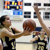 "Monarch High School's Ellie Dietz takes a shot in front of Courtney Smith during a game against Legacy High School on Friday, Jan. 11, at Legacy High School in Broomfield. For more photos of the game go to  <a href=""http://www.dailycamera.com"">http://www.dailycamera.com</a><br /> Jeremy Papasso/ Camera"