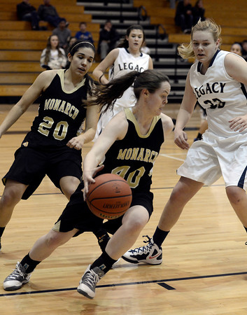 """Monarch High School's Jordan Eisler dribbles the ball past Courtney Smith during a game against Legacy High School on Friday, Jan. 11, at Legacy High School in Broomfield. For more photos of the game go to  <a href=""""http://www.dailycamera.com"""">http://www.dailycamera.com</a><br /> Jeremy Papasso/ Camera"""