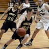 "Monarch High School's Jordan Eisler dribbles the ball past Courtney Smith during a game against Legacy High School on Friday, Jan. 11, at Legacy High School in Broomfield. For more photos of the game go to  <a href=""http://www.dailycamera.com"">http://www.dailycamera.com</a><br /> Jeremy Papasso/ Camera"