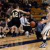 "Monarch High School's Kelly O'Flannigan saves the ball from going our of bounds in front of Caitlyn Smith during a game against Legacy High School on Friday, Jan. 11, at Legacy High School in Broomfield. For more photos of the game go to  <a href=""http://www.dailycamera.com"">http://www.dailycamera.com</a><br /> Jeremy Papasso/ Camera"