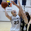 """Legacy High School's Caitlyn Smith takes a shot over Kelly O'Flannigan during a game against Monarch High School on Friday, Jan. 11, at Legacy High School in Broomfield. For more photos of the game go to  <a href=""""http://www.dailycamera.com"""">http://www.dailycamera.com</a><br /> Jeremy Papasso/ Camera"""