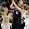 "Legacy High School's Emily Glen takes a shot over Monarch's Ashton Davis, right, and Jordan Eisler, left, during the Class 5A Colorado State Championship game against Monarch High School on Friday, March 9, at the Coors Event Center on the University of Colorado campus in Boulder. Legacy won the game 58-51. For more photos of the game go to  <a href=""http://www.dailycamera.com"">http://www.dailycamera.com</a><br /> Jeremy Papasso/ Camera"