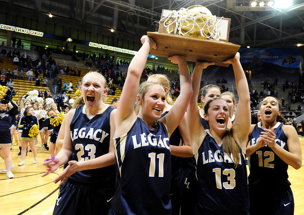 "Legacy High School's Caitlyn Smith, No. 23, Emily Glen, No. 11, Jordan Salaz, No. 13, and Mackenzie Neeley, No. 12, scream to the fans while holding the trophy after defeating Monarch High School in the Class 5A Colorado State Championship game on Friday, March 9, at the Coors Event Center on the University of Colorado campus in Boulder. Legacy won the game 58-51. For more photos of the game go to  <a href=""http://www.dailycamera.com"">http://www.dailycamera.com</a><br /> Jeremy Papasso/ Camera"