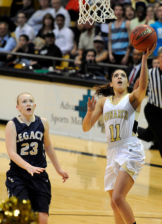 """Monarch High School's Rebecca Richmond goes for a lay-up over Legacy's Caitlyn Smith during the Class 5A Colorado State Championship game on Friday, March 9, at the Coors Event Center on the University of Colorado campus in Boulder. Legacy won the game 58-51. For more photos of the game go to  <a href=""""http://www.dailycamera.com"""">http://www.dailycamera.com</a><br /> Jeremy Papasso/ Camera"""