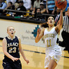 "Monarch High School's Rebecca Richmond goes for a lay-up over Legacy's Caitlyn Smith during the Class 5A Colorado State Championship game on Friday, March 9, at the Coors Event Center on the University of Colorado campus in Boulder. Legacy won the game 58-51. For more photos of the game go to  <a href=""http://www.dailycamera.com"">http://www.dailycamera.com</a><br /> Jeremy Papasso/ Camera"